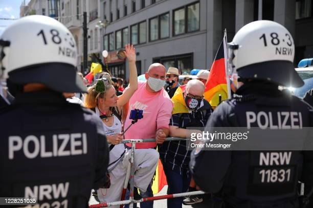 Coronavirus skeptics and rightwing extremists march in protest against coronavirusrelated restrictions and government policy on August 29 2020 in...