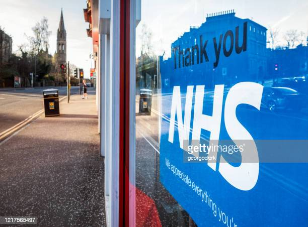 coronavirus: thank you nhs poster in shop window - local politics stock pictures, royalty-free photos & images
