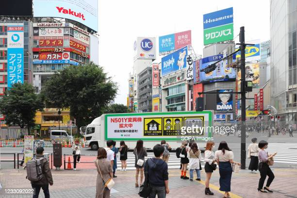 Coronavirus variation is spreading, please refrain from going outside! Is written on a truck organized by the Tokyo City Government to inform the...