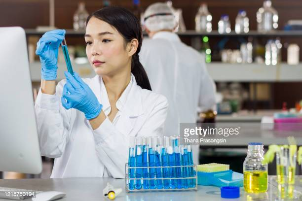 coronavirus-biotechnology research, female scientist mixing a chemical formula - usa stock pictures, royalty-free photos & images