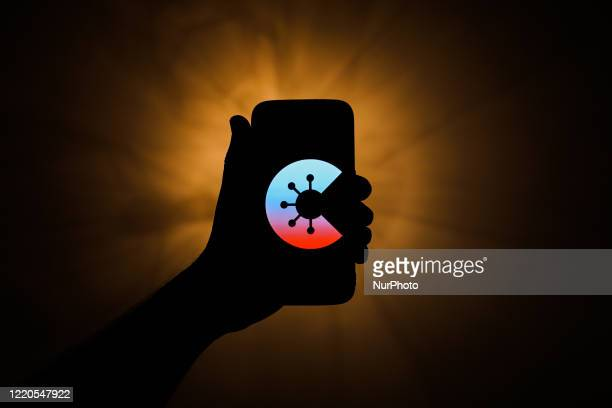CoronaWarnApp icon is displayed on a phone screen in this illustration photo taken on June 16 2020 Launched by German government tracking app is...