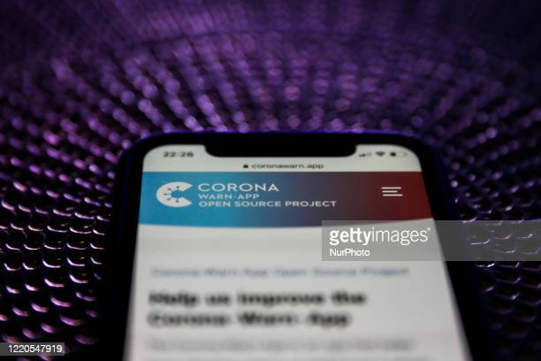 CoronaWarnApp website is displayed on a phone screen in this illustration photo taken on June 16 2020 Launched by German government tracking app is...
