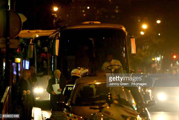 Coroner Lord Justice Scott Baker stands besides the coach carrying the jury across the road from the Pitie Salpetriere Hospital in Paris, where the...