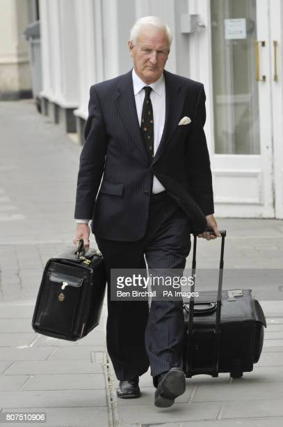 Coroner Mr David Masters arrives at Trowbridge Coroners Court Wiltshire for the last day of the inquest into the deaths of three soldiers who were...