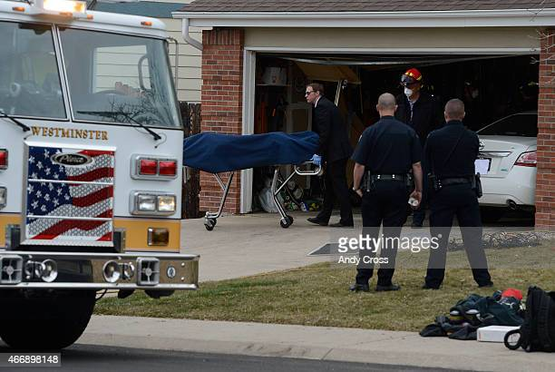 A coroner removes a body on scene scene of a fatal fire near 97th Place and Teller Ct in Westminster March 19 2015