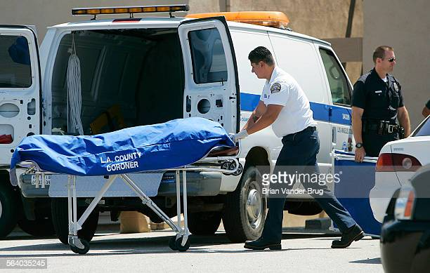 Coroner removes body of a woman after a shooting in Chatsworth that may have resulted form a domestic dispute left one person dead today June 3 2005...