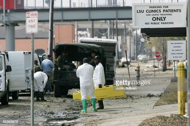 A coroner team preapres to remove a body from a building at the LSU Medical Center September 13 2005 in New Orleans Louisiana More than 40 bodies...