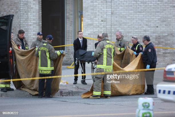 Coroners carry the body of a victim after 10 people were killed and 15 people injured in a deadly van attack in Toronto Ontario Canada on April 23...