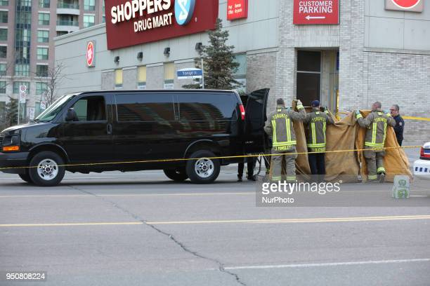 Coroners load the body of a victim into their van after 10 people were killed and 15 people injured in a deadly van attack in Toronto Ontario Canada...