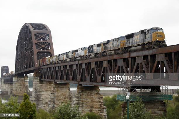 Corp freight train crosses a bridge over the Ohio River into Clarksville Indiana US on Thursday Oct 12 2017 CSX is scheduled to release earnings...