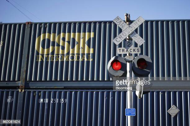 Corp intermodal container train passes a railroad crossing sign in Louisville Kentucky US on Friday Oct 13 2017 CSX is scheduled to release earnings...
