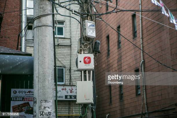 KT Corp Olleh WiFi Giga internet routers are attached to a utility pole in the Gangnam district of Seoul South Korea on Sunday Jan 28 2018 5G the...