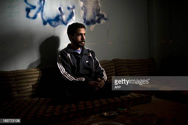 Corporal Ala Ibrahim, a 22-year-old Syrian army soldier who was captured by the rebels earlier this year, sits in a room as he is held in school...