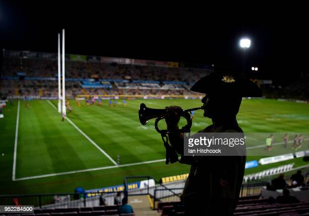 Corporal Ben Cobden of the Australian Army poses with the Bugle before the start the round eight NRL match between the North Queensland Cowboys and...