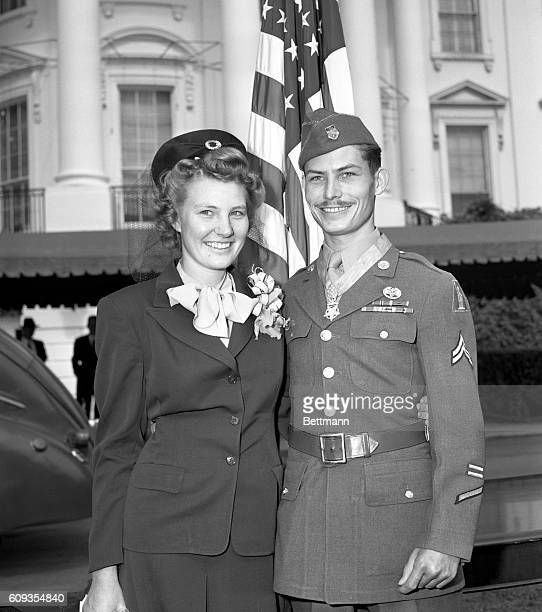 Corporal Desmond T Doss Lynchburg VA a conscientious objector with his wife after ceremonies in the White House gardens during which he and fourteen...