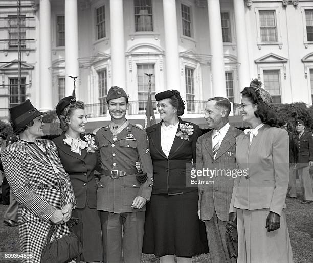 Corporal Desmond T Doss Lynchburg VA a conscientious objector with his wife and family after ceremonies in the White House gardens during which he...