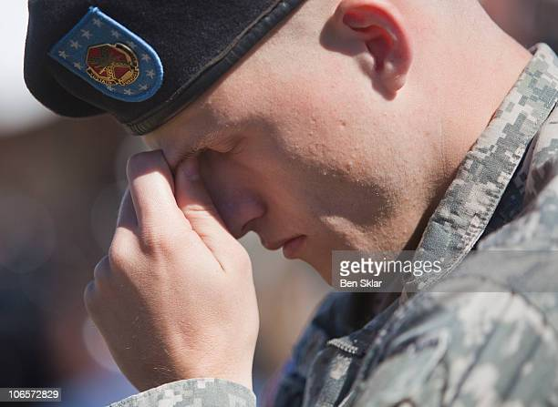 Corporal Eric Skoog observes a moment of silence at a remembrance service recognizing the 13 victims killed in the Ft Hood attacks on the one year...