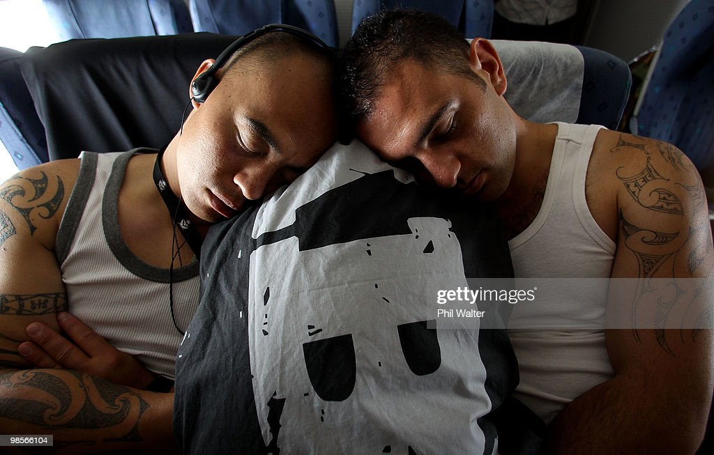 Corporal Jason Wharewera (L) and Lance Corporal Frank Vokaty (R) from the New Zealand Defence Force take a nap on the Boeing 757 enroute to Gallipoli on April 20, 2010 over Darwin, Australia. April 25 will commemorate the 95th anniversary of ANZAC (Australia New Zealand Army Corps) Day, when First World War troops landed on the Gallipoli Peninsula, Turkey early April 25, 1915.