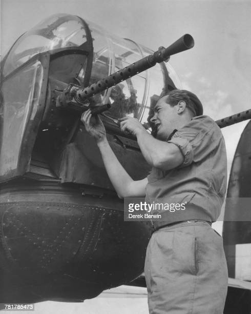 Corporal John Smith maintains the two 50 in M2 Browning machine guns in the rear gun turret of an Avro Lincoln B2 fourengined heavy bomber of No 49...