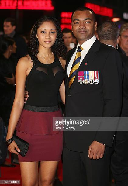 Corporal Johnson Beharry and guest attend the World Premiere of Gambit at Empire Leicester Square on November 7 2012 in London England