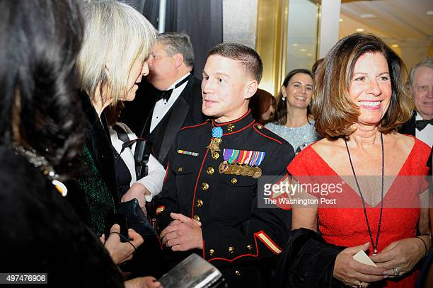 Corporal Kyle Carpenter chats with guests at the National Portrait Gallery gala November 15 2015 in Washington DC The honorees of the first American...