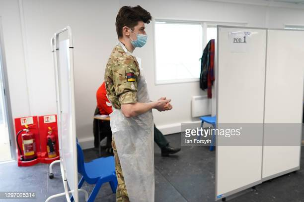Corporal Lee Cook from 5 Medical Regiment waits for his next patient at the Askham Bar Mass Vaccination Centre in York on January 18, 2021 in York,...