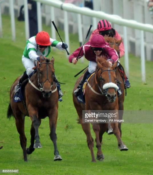 Corporal Maddox ridden by Jim Crowley on his way to winning The Investic Woodcote Stakes during The Investec Derby Day at Epsom Racecourse London
