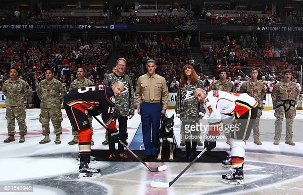 Corporal Nero and Lance Corporal Brandon C Benningfield center are joined by Ryan Kesler of the Anaheim Ducks Mark Giordano of the Calgary Flames...