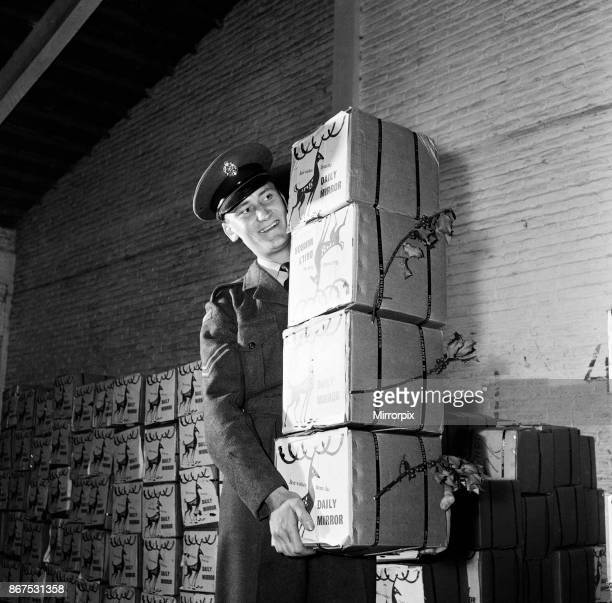 Corporal Peter Symmonds at a Nicosia airfield with hampers packed with good things they are gift from the Daily Mirror on behalf of its millions of...