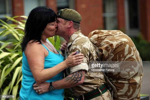 Corporal Sean Jack of 2nd Battalion The Yorkshire Regiment kisses his fiance Jo Richardson goodbye as he and comrades leave their barracks in...