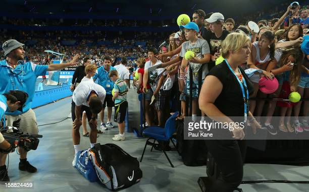 A corporate box facia gives way as spectators surge to get an autograph from Novak Djokovic of Serbia after playing his singles match against Andreas...