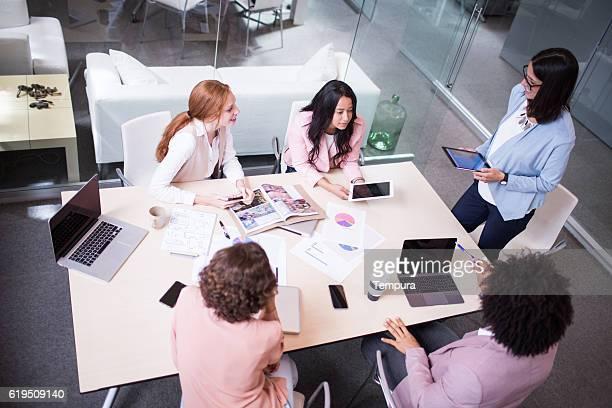 Corporate business meeting in board room.