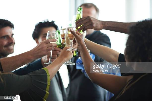 corporate co-workers having drinks after meeting - happy hour stock pictures, royalty-free photos & images