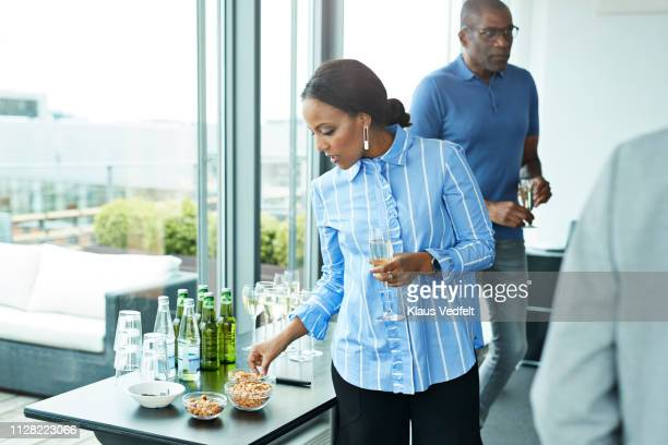 corporate co-workers having drinks after meeting - snack stock pictures, royalty-free photos & images