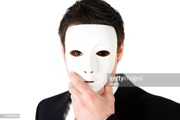 Corporate crime Business man wearing a face mask suit isolated