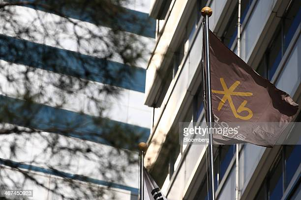 A corporate flag flies at the KB Financial Group Inc headquarters in Seoul South Korea on Thursday Feb 6 2014 KB Financial owner of the nation's...