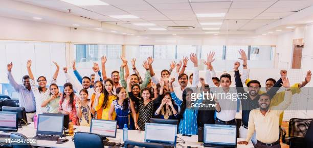 corporate group portrait of cheering staff members - employee stock pictures, royalty-free photos & images