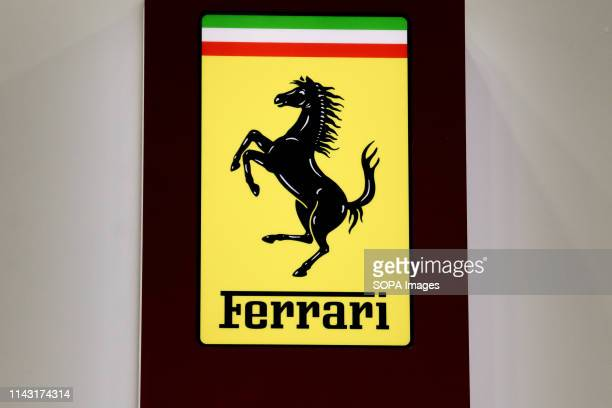 Corporate image of the automotive brand Ferrari that exhibits its vehicles seen at the Automobile Trade Fair 2019 in Barcelona
