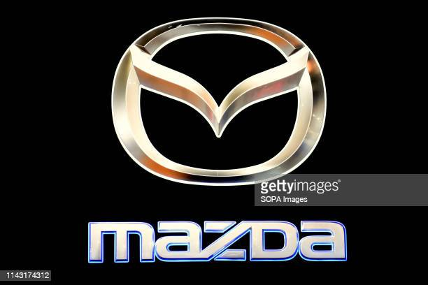 Corporate image of the automotive brand Mazda that exhibits its vehicles seen at the Automobile Trade Fair 2019 in Barcelona