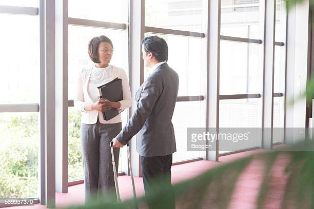 Corporate Japanese Business Man Talks with Executive Black Woman