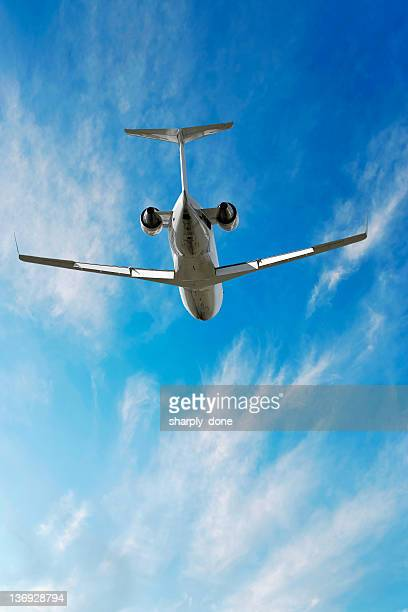 XXL corporate jet airplane flying in bright sky