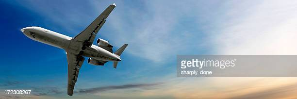 corporate jet airplane landing at dusk