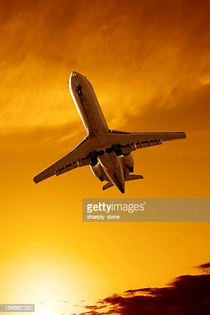 XXL corporate jet airplane landing at sunset