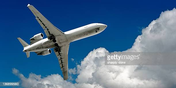 corporate jet airplane landing in cloudy sky