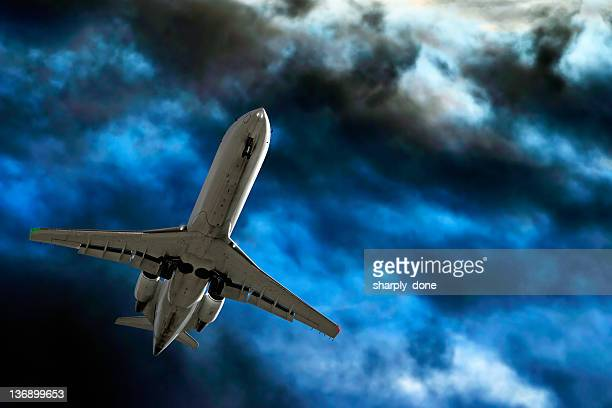 corporate jet airplane landing in storm