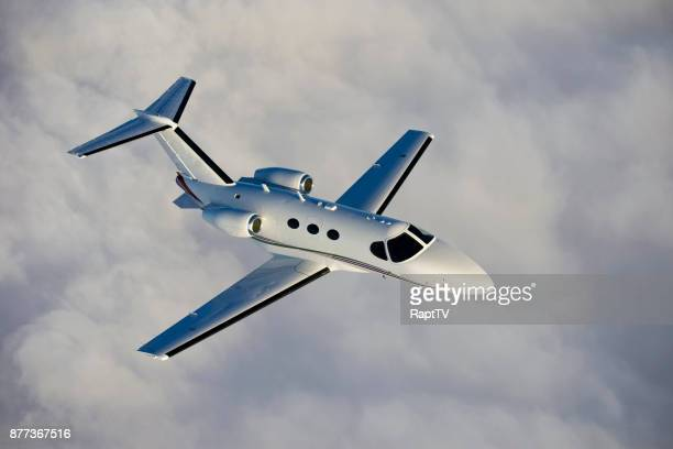 a corporate jet in-flight. - air vehicle stock pictures, royalty-free photos & images