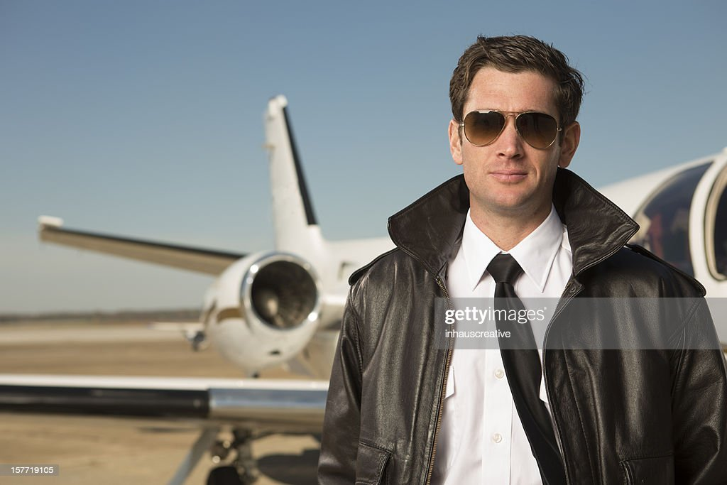 Corporate Jet pilot in front of private plane : Stock Photo