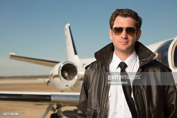 Corporate Jet pilot in front of private plane