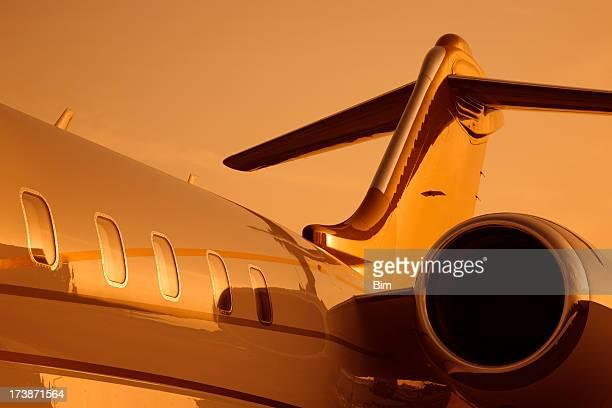 Corporate jet under orange sunset light