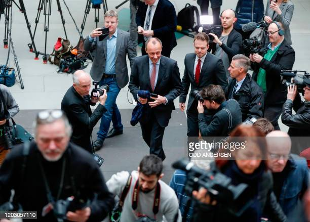 Corporate lawyer and former CDU parliamentary group leader Friedrich Merz iss surrounded by media as he arrives to address a press conference on...
